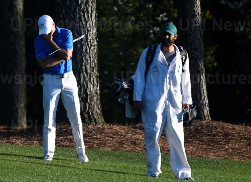 Jordan Spieth covers his face on the 18th fairway at the Masters
