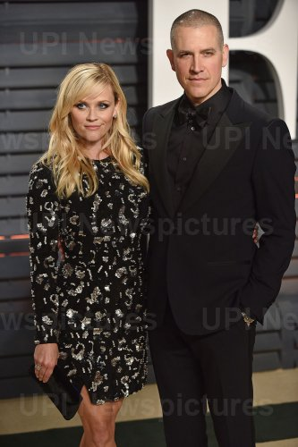 Reese Witherspoon and Jim Toth arrive for the Vanity Fair Oscar Party in Beverly Hills