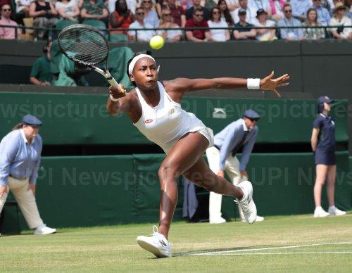 Cori Gauff returns in her fourth round match against Simona Halep at Wimbledon
