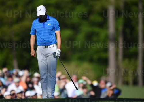 Jordan Spieth reacts after hitting a ball in the water at the Masters