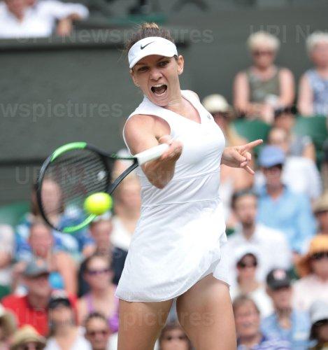 Simona Halep celebrates victory in her match against Elina Svitolina