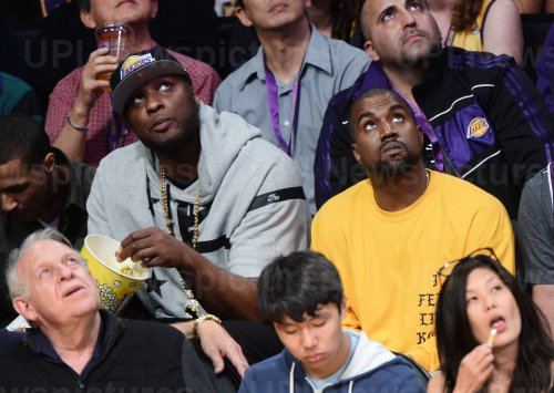 Lamar Odom and Kanye West attend Kobe Bryant's final game as a Laker in Los Angeles