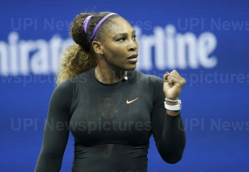 Serena Williams celebrates after defeating Qiang Wang at the US Open