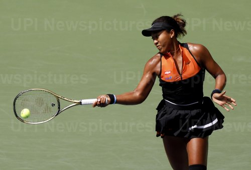 Naomi Osaka of Japan hits a forehand at the US Open