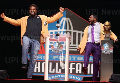 Ray Lewis and Jonathan Ogden do a dance at the Pro Football Hall of Fame