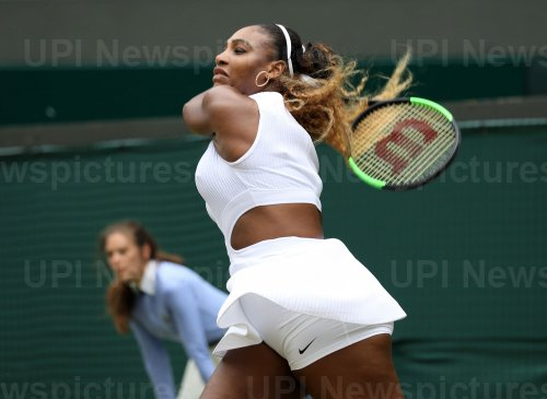 Serena Williams celebrates victory in her match against Julia Georges