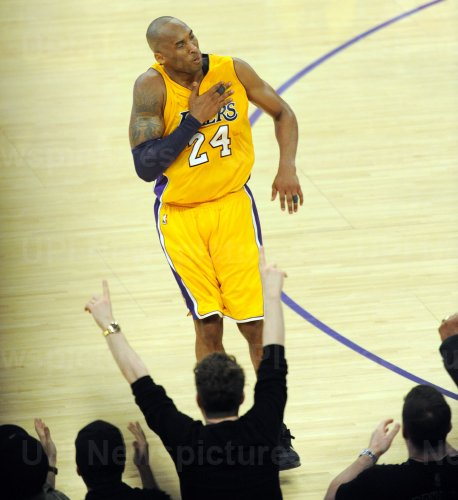 Los Angeles Lakers Kobe Bryant reacts after making a basket in the second half in his final game