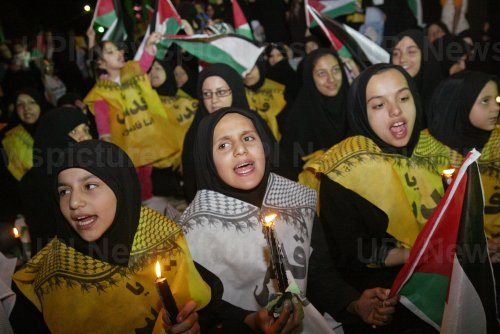 Iranians attend in an anti-Israel gathering marking Israel's 60th Independence Day in Tehran