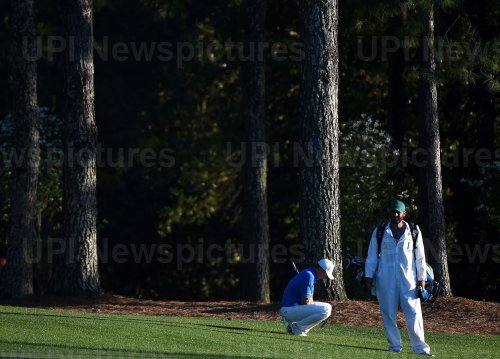 Jordan Spieth reacts on the 18th fairway at the Masters