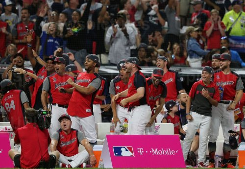 American League players cheer for Blue Jays' Vladimir Guerrero Jr. during the MLB All-Star Home Run Derby