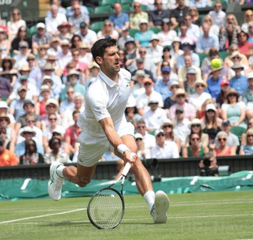 Novak Djokovic rerturns the ball in his Quarter-Final match against David Goffin