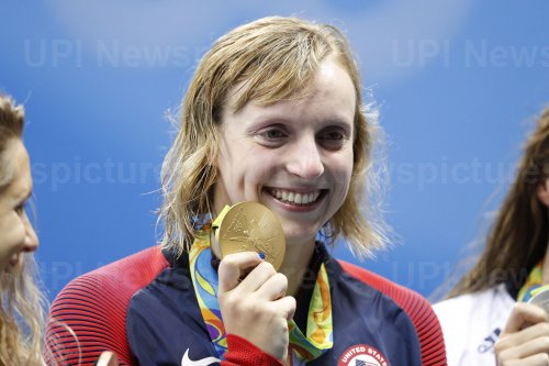 Katie Ledecky (USA) shows off her gold medal in the Women's 800M Freestyle at the 2016 Rio Olympics