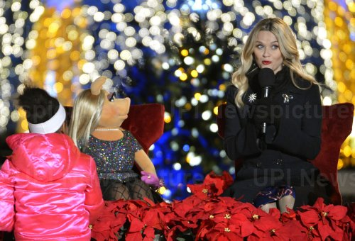 Actress Reese Witherspoon and Miss Piggy attend the lighting of the National Christmas Tree in Washington