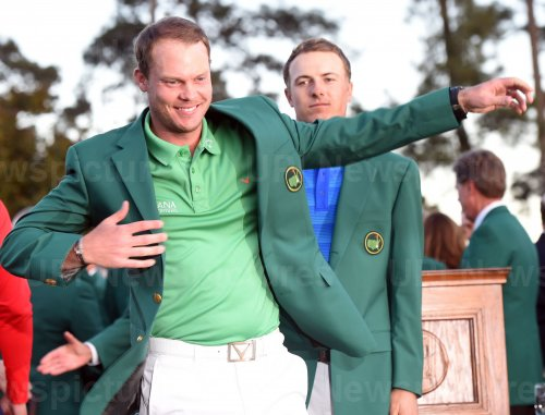 Jordan Spieth puts the Green Jacket on Danny Willett