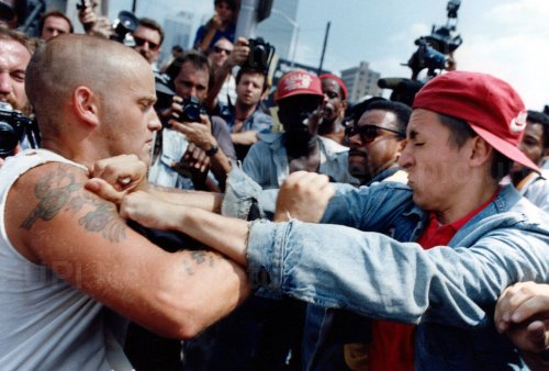 A Ku Klux Klan supporter and an anti-Klan protester exchange blows.