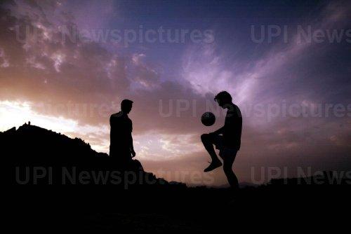 BOYS PLAY FOOTBALL IN BAM