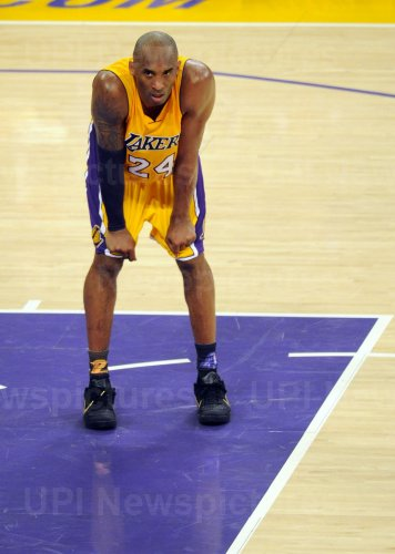 Los Angeles Lakers Kobe Bryant tries to catch a breather in the second half in his final game