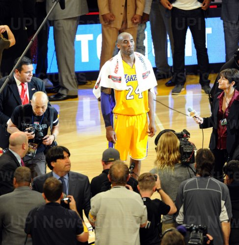 Los Angeles Lakers Kobe Bryant gets ready to say goodbye to the fans at the end of his final game