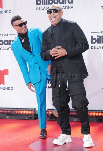 Alexander Delgado and Randy Malcom of Gente De Zona walk the red carpet at the 2020 Latin Billboard Awards in Sunrise, Florida