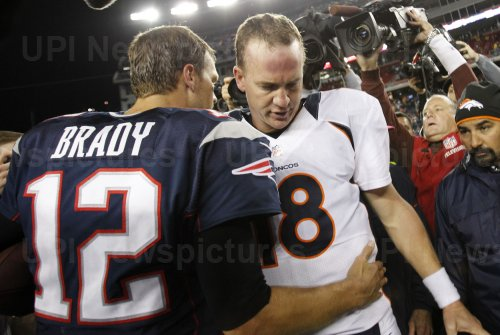 Patriots Brady shakes hands with Broncos Manning at end of game at Gillette Stadium in Foxboro, MA
