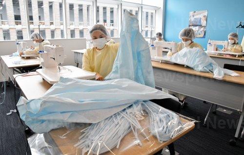 All Nippon Airways staffs make medical gowns in Tokyo