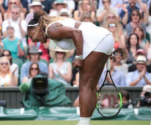Serena Williams returns the ball in the Wimbledon Women's Final match against Simona Halep