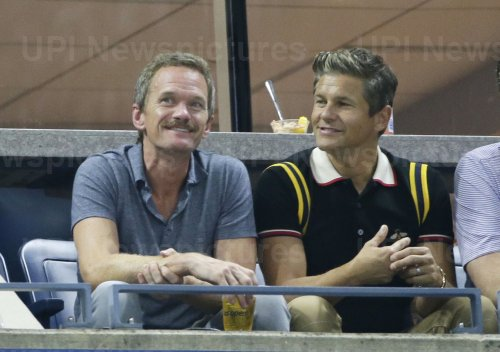 Neil Patrick Harris watches tennis at the US Open