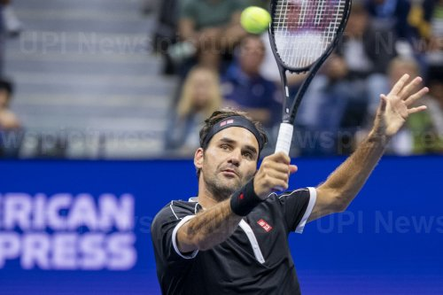 Roger Federer hits a forehand at the US Open