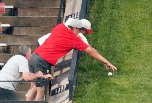 Fans Reach For Home Run Ball