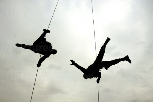 Iranian police perform during a military parade in Tehran