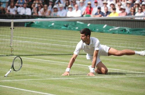 Novak Djokovic dives for the ball in his Semi-Final match against Robero Bautista Agut