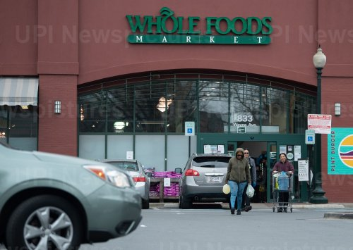 Shoppers enter a Whole Foods in Maryland