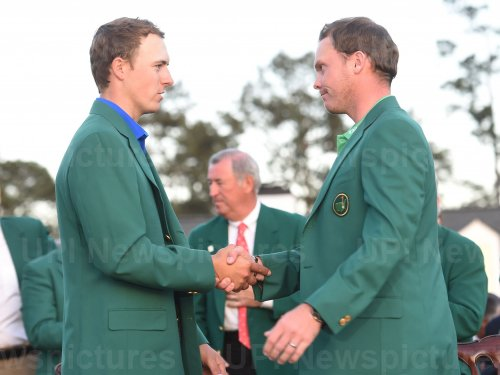 Jordan Spieth puts the Green Jacket on Danny Willett