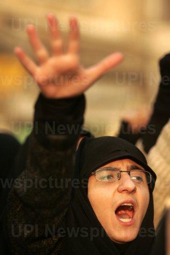 Iran's hardline Islamist Basij militia demonstrate to support Gaza in front of the British embassy in Tehran
