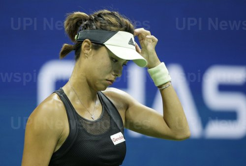 Qiang Wang of China scratches her head at the US Open