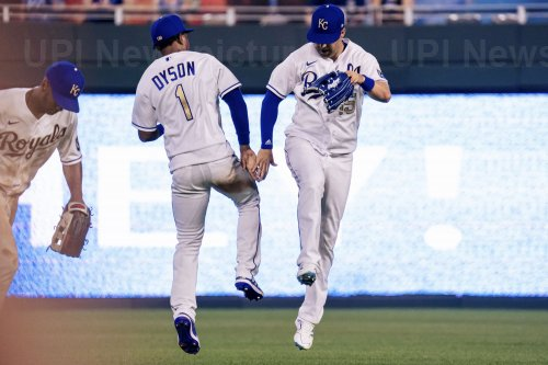 Royals Jarrod Dyson and Whit Merrifield Celebrate the Win Against the Red Sox