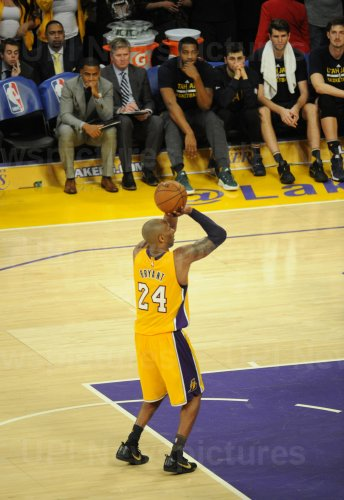 Los Angeles Lakers Kobe Bryant makes a free-throw for his final point in his last game in the NBA
