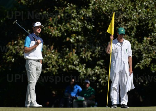 Bubba Watson stands on the 11th green at the Masters