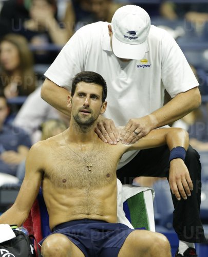 Novak Djokovic of Serbia gets a massage at the US Open