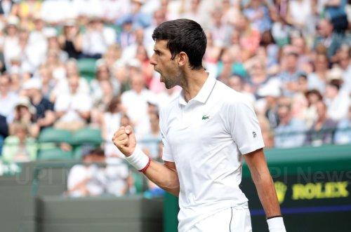 Novak Djokovic rerturns the ball in his match against Hubert Hurkacz