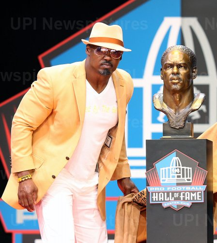 Brian Dawkins poses with his bust at the Pro Football Hall of Fame