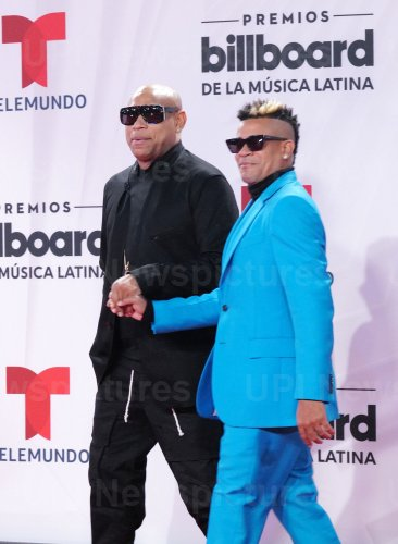 Alexander Delgado and Randy Malcom of Gente De Zona walk the red carpet at the 2020 Latin Billboard Awards in Sunrise, Florida