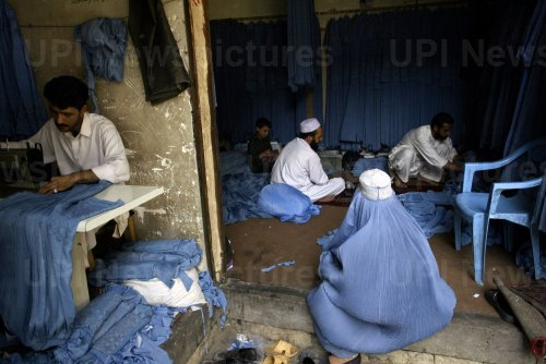 Afghans make burqas in Herat, Afghanistan