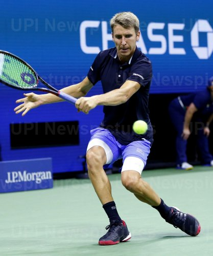 Cedrik-Marcel Stebe hits a backhand at the US Open